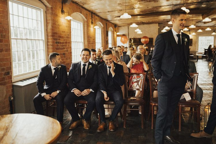 Groomsmen in Next Suits at the Altar