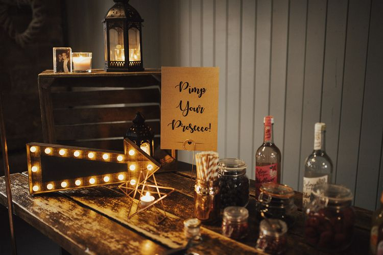 Pimp Your Prosecco Station with Marquee Arrow Light and Berries
