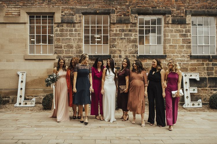 Bride in Charlie Brear Wedding Dress and Her Best Girls in Jewel Toned Wedding Guest Outfits