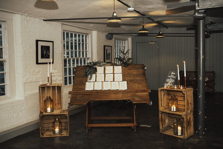 Wedding Decor with Wooden Crates, Copper Candlesticks and Table Plan