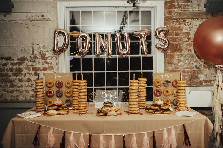 Doughnut Cake Station with Towers, Walls and Gold Foil Balloon Sign