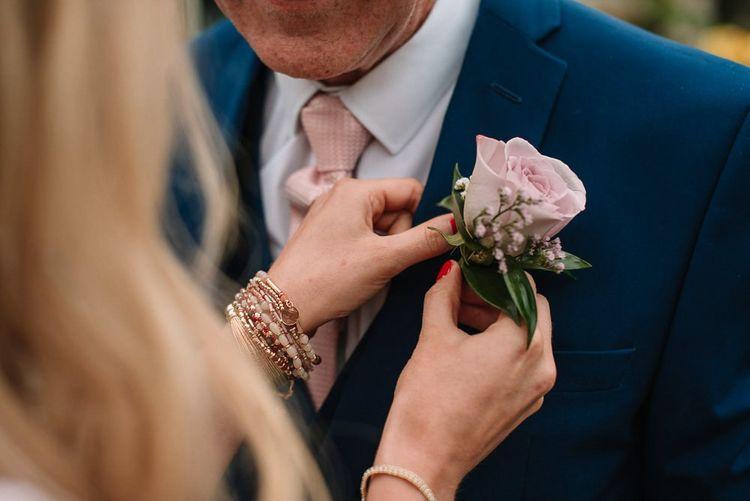 Blush flower buttonhole at Irish wedding
