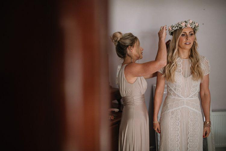 Bride in Watters wedding dress with flower crown