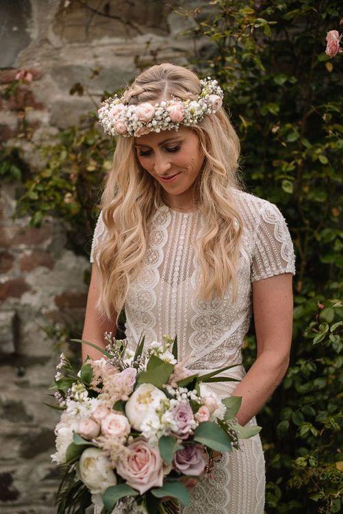 Bride wears Watters wedding dress and flower crown