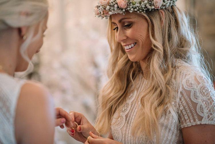 Bride wears pink flower crown at same-sex wedding
