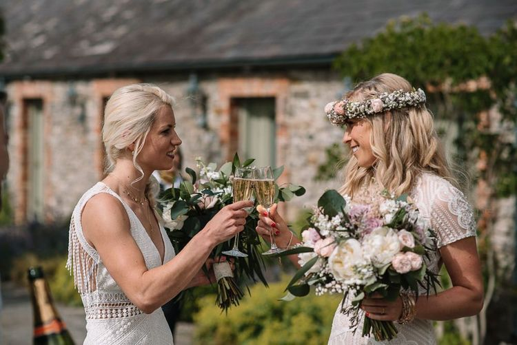 Bride and bride toast their big day