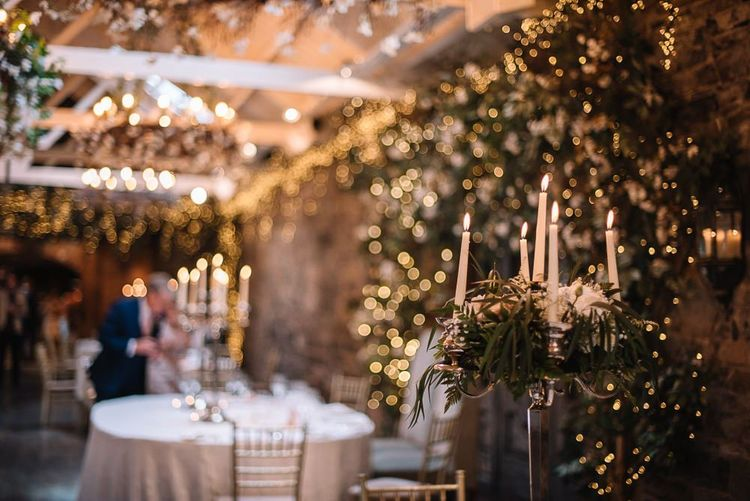 Beautiful wedding lighting with candles at Ballymagarvey Village in Ireland