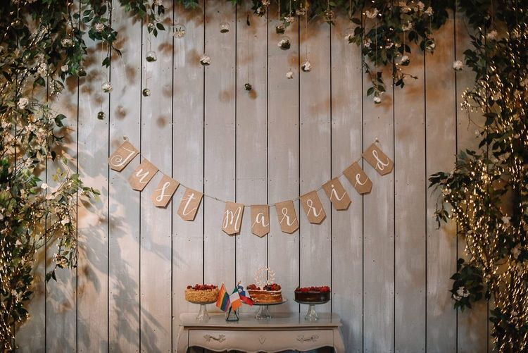 Wedding cake table with just married bunting