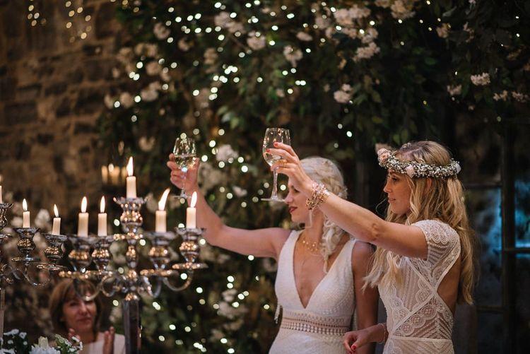 Brides toast the wedding speeches at Ballymagarvey Village in Ireland