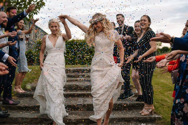 Confetti exit for brides wearing Watters wedding dress
