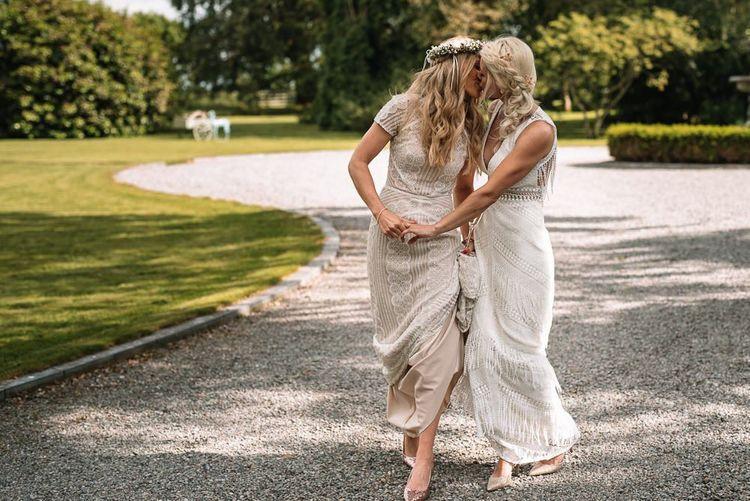 Bride and bride in Watters wedding dress