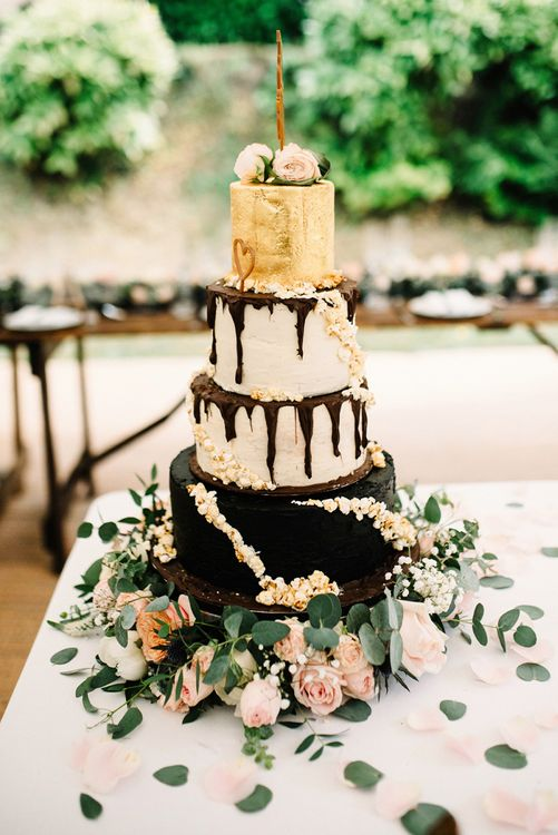 Homemade Four Tier Round Wedding Cake with Chocolate and Gold Layers and Drip Icing