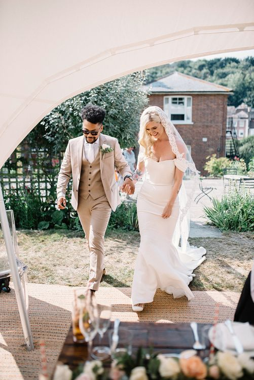 Real Bride in Pronovias Raciela Wedding Dress  and Groom in Bright Three Piece Moss Bros. Suit