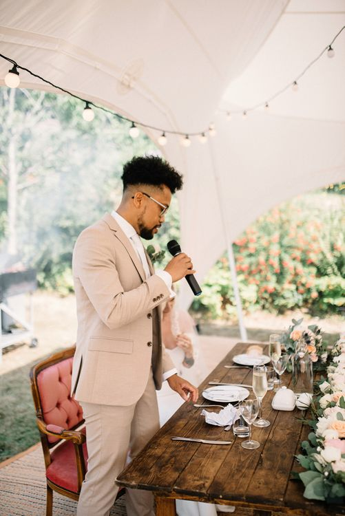 Groom Giving His Wedding Speech under a Stretch Tent with Festoon Lights