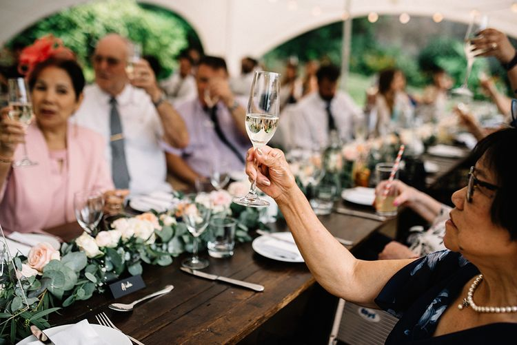 Wedding Guests Raising Their Glasses During the Speeches