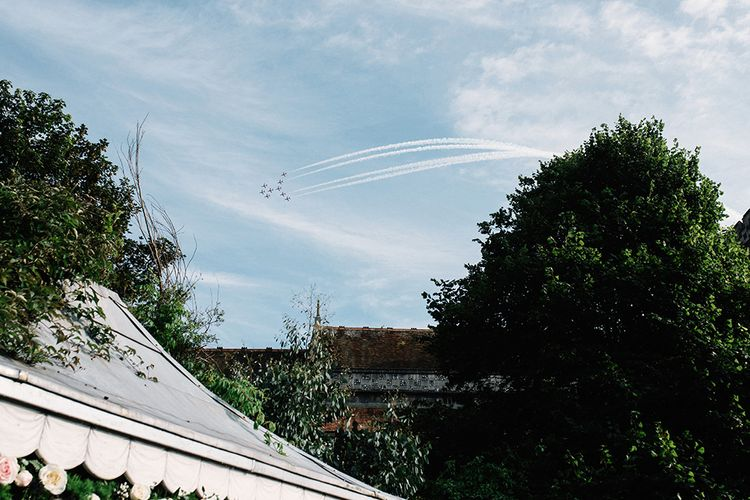 Red Arrow Fly Over During Wedding Reception