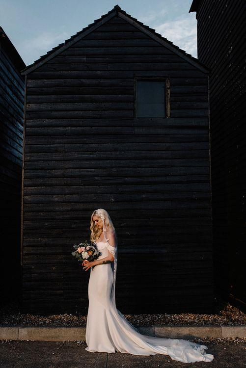 Glamorous Bride with Finger Waves Hair, Lace Edged Veil and Raciela  Pronovias Wedding Dress