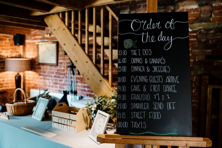 Chalkboard Order of The Day Sign | Wedding Decor | Intimate Greenery Wedding at Packington Moore Rustic Wedding Venue | Amy Faith Photography | Floodgate Films