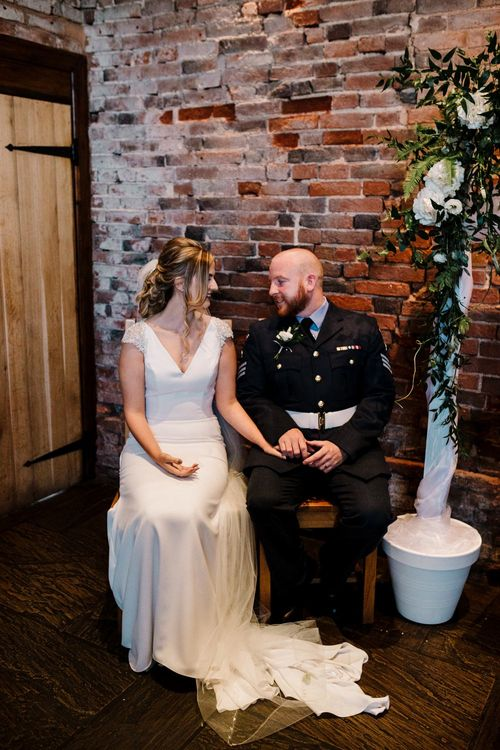 Wedding Ceremony | Bride in 'Milan' St Patrick Gown | Groom in Military Uniform | Intimate Greenery Wedding at Packington Moore Rustic Wedding Venue | Amy Faith Photography | Floodgate Films
