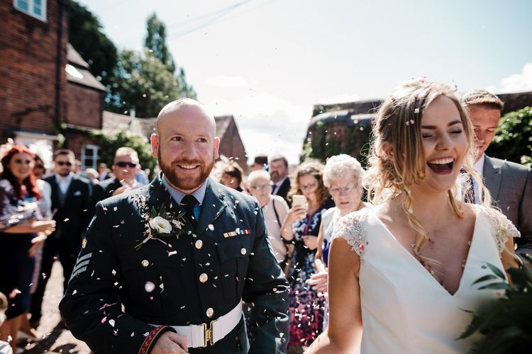Confetti Moment | Bride in 'Milan' St Patrick Gown | Groom in Military Uniform | Intimate Greenery Wedding at Packington Moore Rustic Wedding Venue | Amy Faith Photography | Floodgate Films