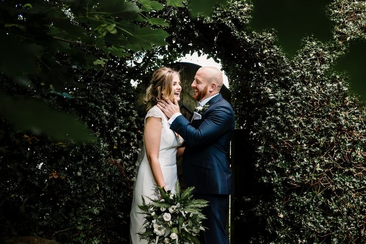 Bride in 'Milan' St Patrick Gown | Groom in Navy Suit & Grey Tweed Waistcoat | Intimate Greenery Wedding at Packington Moore Rustic Wedding Venue | Amy Faith Photography | Floodgate Films