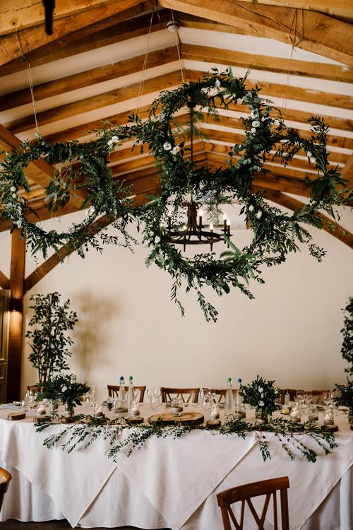 Top Table Wedding Decor with Hanging Greenery Hoops | Intimate Greenery Wedding at Packington Moore Rustic Wedding Venue | Amy Faith Photography | Floodgate Films