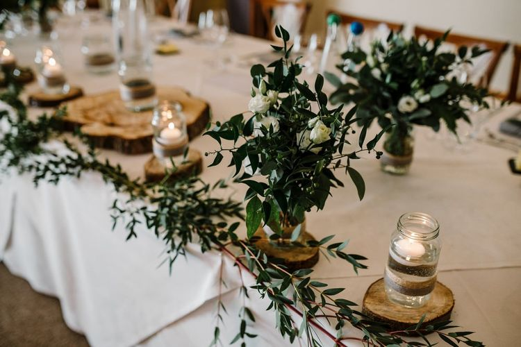 Rustic Top Table Wedding Decor with Foliage & White Floral Centrepieces | Intimate Greenery Wedding at Packington Moore Rustic Wedding Venue | Amy Faith Photography | Floodgate Films