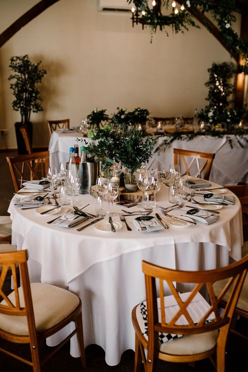 Tree Slice & Foliage in Jars Reception Table Decor | Intimate Greenery Wedding at Packington Moore Rustic Wedding Venue | Amy Faith Photography | Floodgate Films