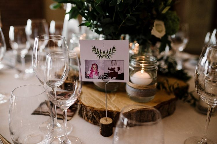 Tree Slice & Foliage in Jars Centrepiece | Intimate Greenery Wedding at Packington Moore Rustic Wedding Venue | Amy Faith Photography | Floodgate Films