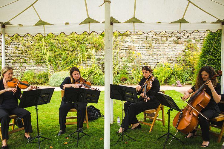 String Quartet. A Bank Holiday Extravaganza. Ceremony at Haddon Hall, Derbyshire