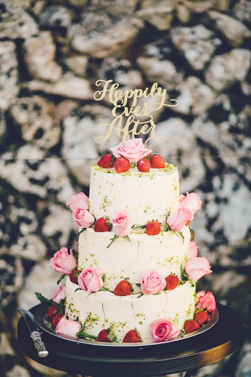 Wooden Laser Cut 'happily Ever After' Wedding Cake Topper on Three Tier Wedding Cake with Strawberry Decor