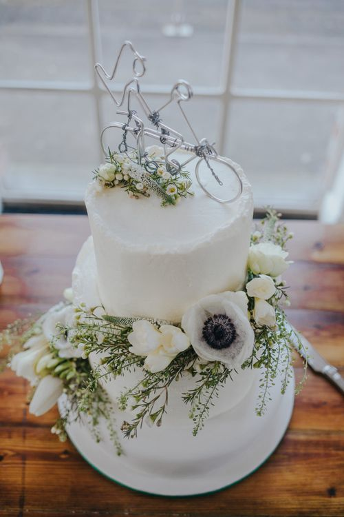 Homemade Wire Tandem Wedding Cake Topper on a White Icing Cake
