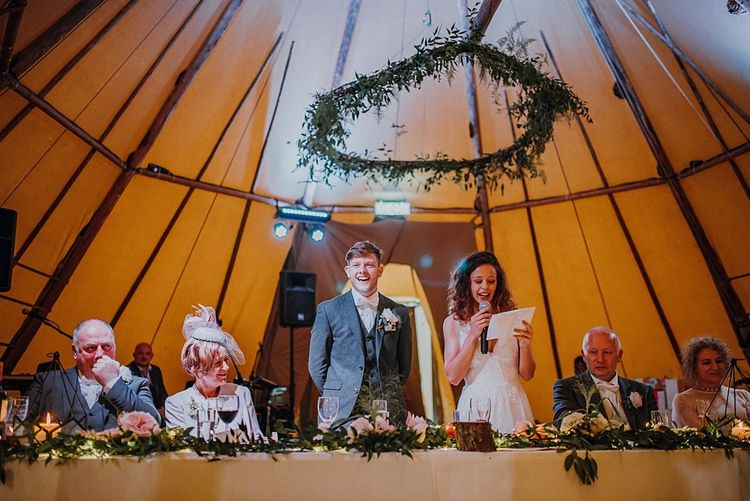Rustic Hoop Decor Tipi Wedding Image by Claire Fleck Photography