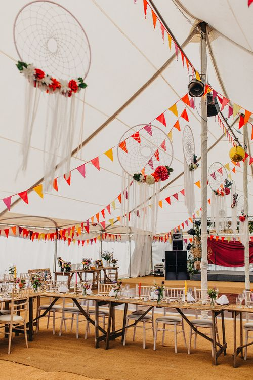 Hanging Wedding Hoops And Bright Bunting Image by Peppermint Love Photography