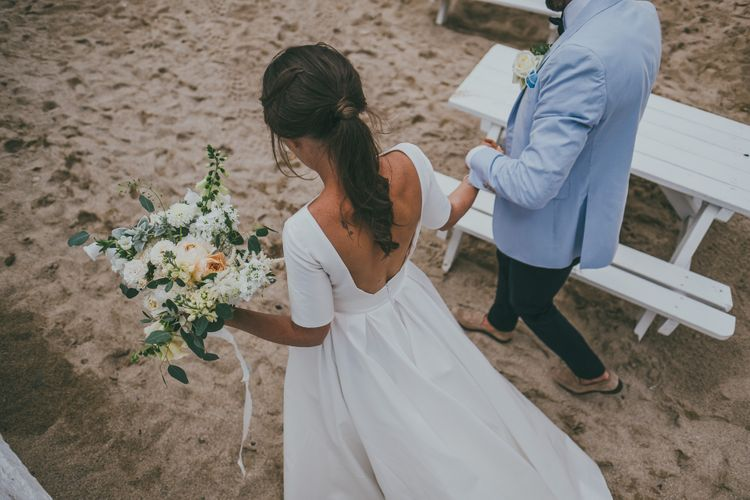 Bride With Pony Tail // Lusty Glaze Beach Wedding // Image By Ross Talling Photography