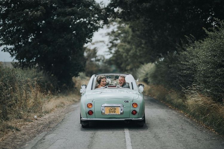 Bride and Groom Driving off into the Sunset
