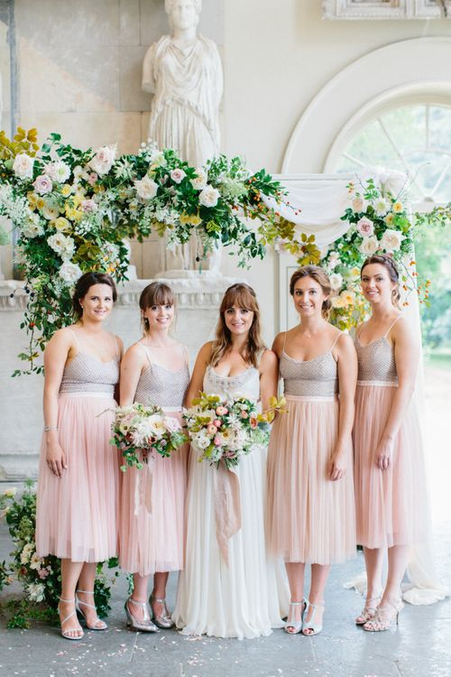 Bride and Bridesmaid Portrait with Floral Arch