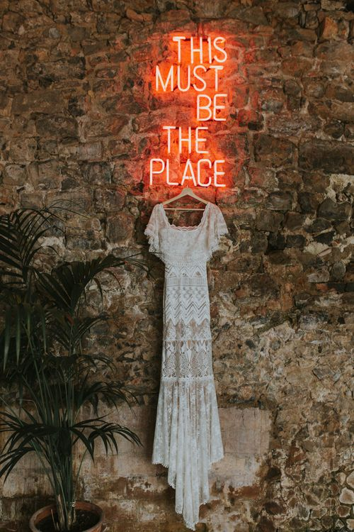 This Must Be The Place Neon Sign and Lace Wedding Dress