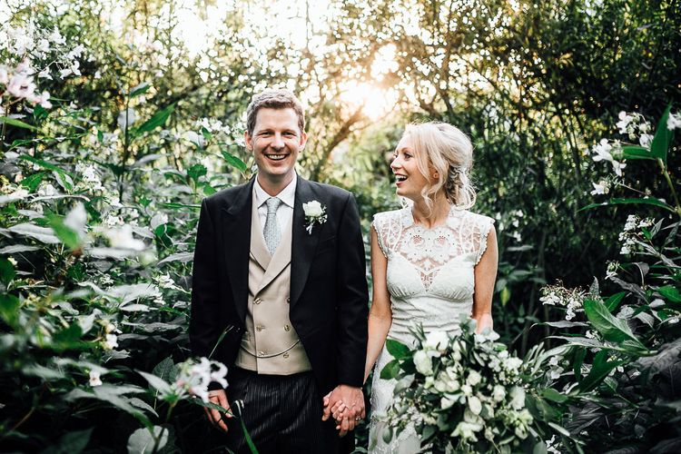 Bride and Groom Portrait with Sun Spray Through The Bushes
