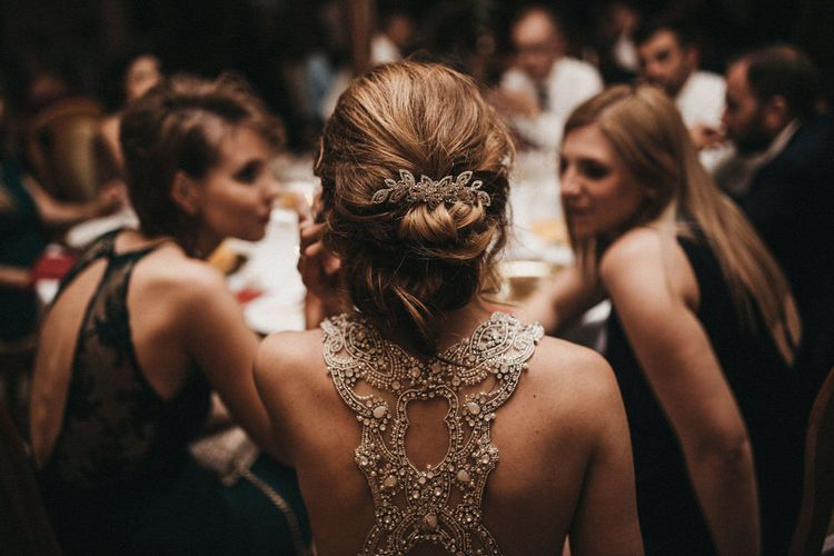 Bride with Beaded Racer Back Wedding Dress and Chic Bridal Hairstyle