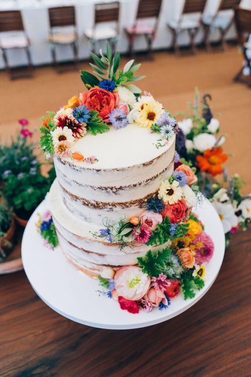 Semi Naked Wedding Cake with Bright Flowers Wedding Decor