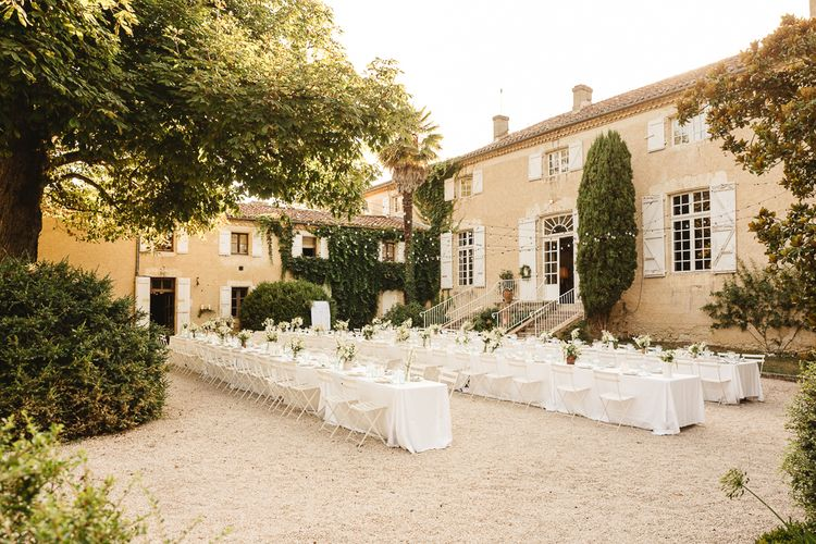 Outdoor Reception in French Chateau Courtyard with Festoon Lights