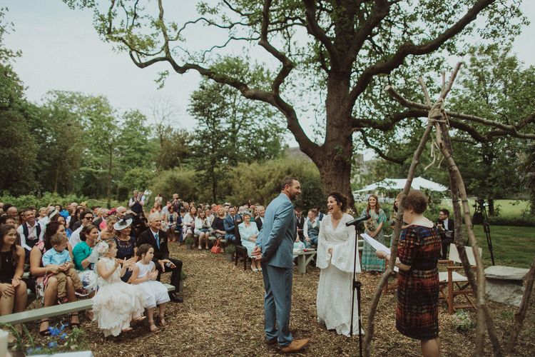 Outdoor Boho Wedding Ceremony with Naked Tipi Altar