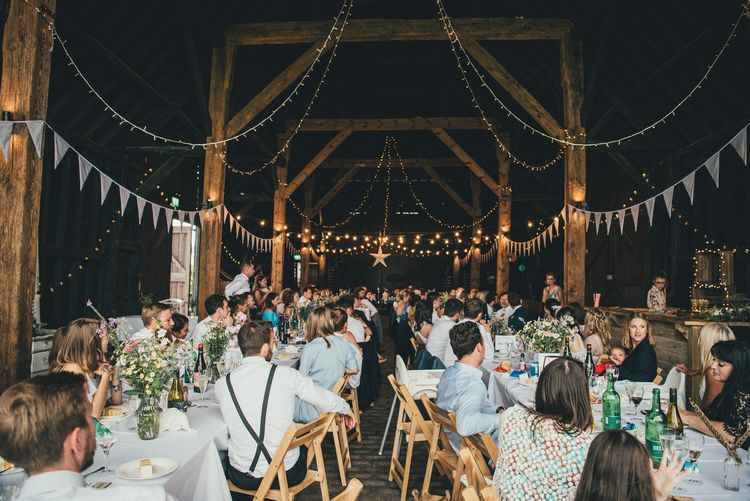 Exclusive Use Barn Wedding Venue with Bunting and Fairy Light Wedding Decor