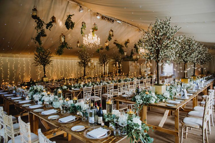 Gold and Green Wedding Reception with Fairylights and Tree Wedding Decor