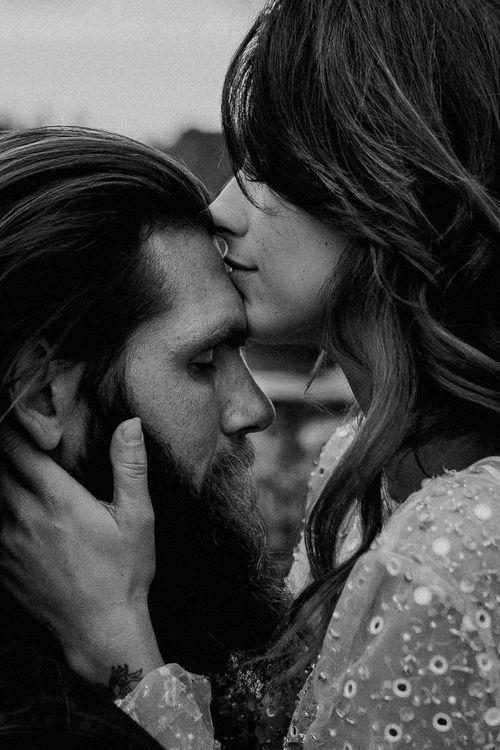 Black & White Portrait of Bride Kissing Grooms head