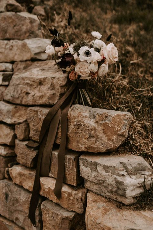 Wedding Bouquet on Rocks Tied with Ribbon