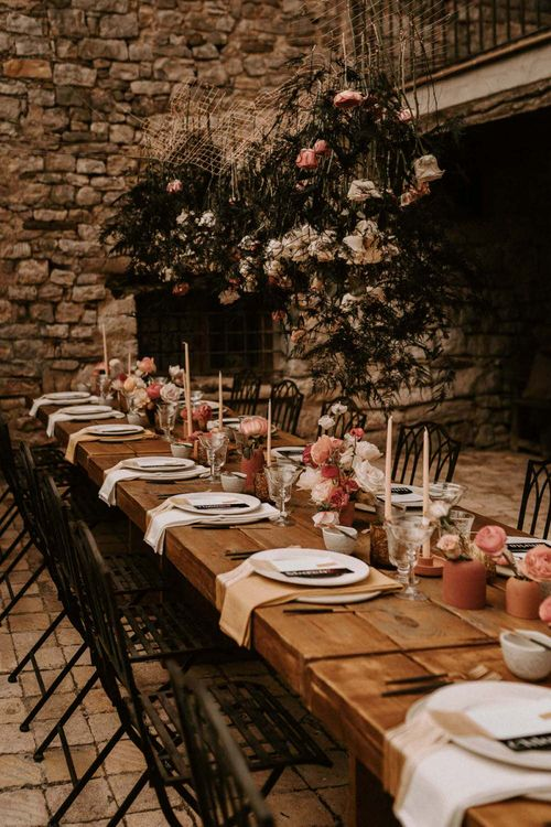 Outdoor Rustic Tablescape with Taper Candles, Floral Centrepieces and Hanging Installation