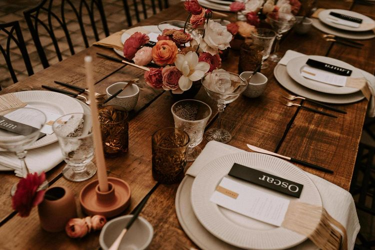Table Settings with Coloured Goblets, Candle Sticks, Ornate Tableware and Black Stationery