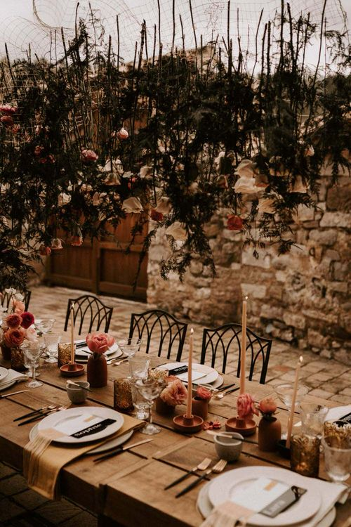 Hanging Flower Stems Over Wedding Reception Table
